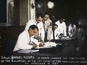 Manuel Roxas signs the Constitution