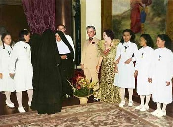 President Manuel L. Quezon and First Lady Aurora Quezon welcome schoolgirls and nuns