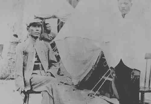Apolinario Mabini sits outside his tent in Guam 1902