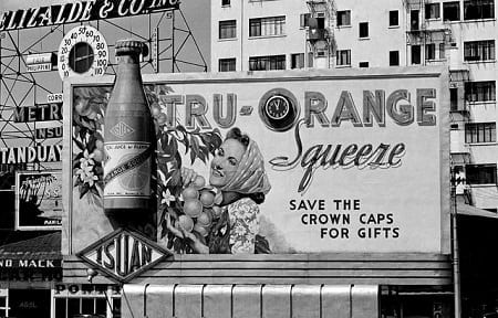 Billboard advertisement for Tru-Orange Drink, north bank of the Pasig River west of the Jones Bridge, Manila, Philippines, 1940.