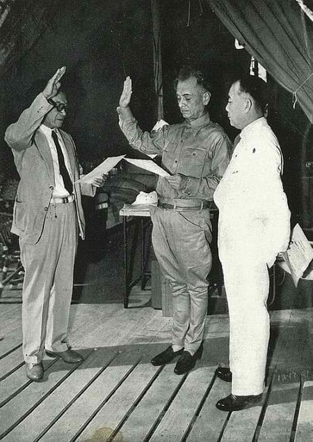 President Manuel L. Quezon swearing in Dr. Jose P. Laurel as Secretary of Justice of the War Cabinet