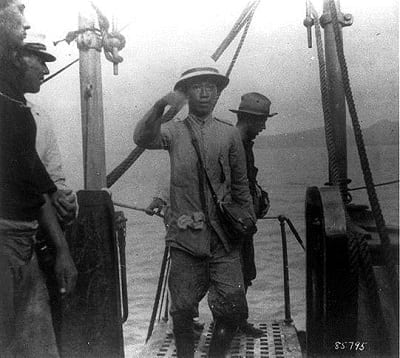 Aguinaldo boarding USS Vicksburg following his capture in 1901