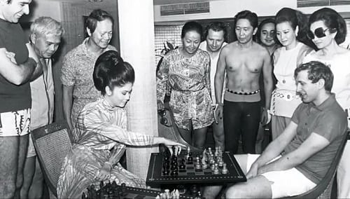 First Lady Imelda playing chess with Bobby Fischer