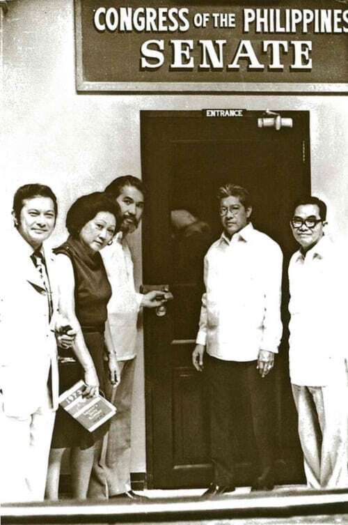 Senators Doy Laurel, Eva Estrada Kalaw, Ramon Mitra, and Jovito Salonga posing in front of the Senate session hall which had been padlocked