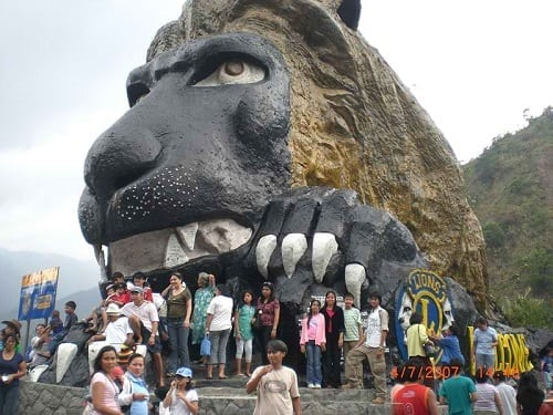 The man-made Lion's Head and tourists