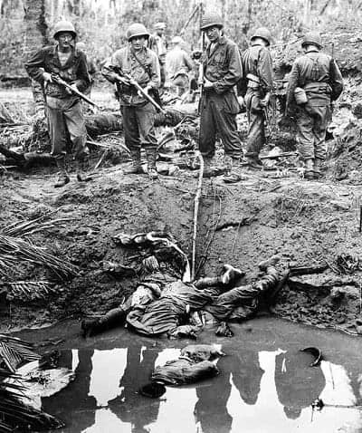 Four Japanese snipers shot and killed in the muddy water of a bomb crater