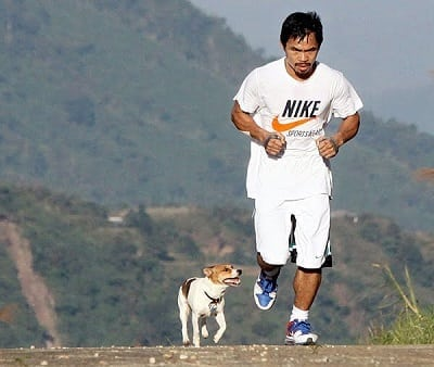 manny pacquiao running with dog