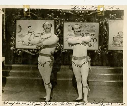 old time acrobats wearing tight fitting shorts