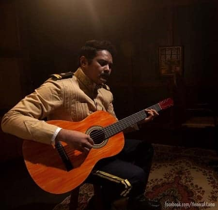 Heneral Luna playing a guitar