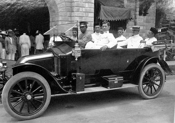 Frank Carpenter, Hadji Butu and the Sultan of Sulu Kiram II riding an early 20th century automobile