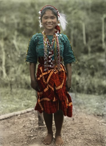 A young Ilongot woman smiles for a portrait