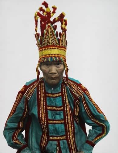 A Bukidnon chief wears a head ornament indicating he has killed men.