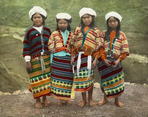 Four Benguet Igorot schoolgirls pose for a portrait in northern Luzon