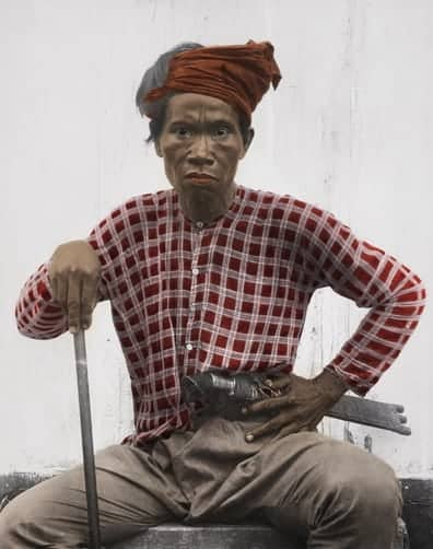 Tagakaolo man in traditional garb holding knife at waist